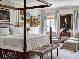 A handsome four-poster bed from Grizzel & Mann offers refuge in the master bedroom. Pale fabrics underscore that tranquility, particularly the icy blue woven damask fabric from Anna French, used for the draperies and the bed's throw. Benjamin Moore's Overcast paint envelops the room.