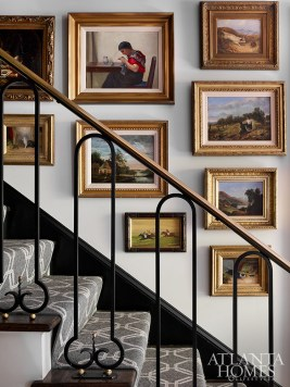 Lasting Impressions In the foyer, a portion of the homeowners' treasured collections greet guests, like the antique dog paintings and landscapes that line the stairwell.
