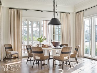 """""""Keep it simple"""" was Webb's mantra when decorating this house, particularly when it came to the breakfast room. Palacek's rope dining chairs surround a Noir dining table."""