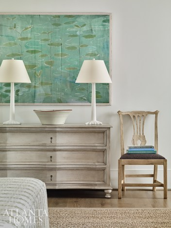 """French textile artist Paule Marrot's """"Lillies,"""" a print the designer obtained from Max & Company, offers a splash of color in the otherwise neutral master bedroom."""