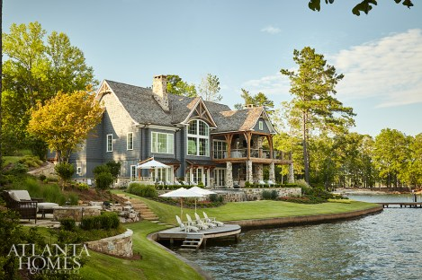 Thanks to the lot's peninsula-like point, nearly every room in the home opens to expansive views of the surrounding water.