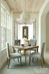 The multifunctional breakfast nook hosts a flurry of activities, from morning pancakes to late night card games. The whitewashed pecky cypress ceilings add natural dimension and further define the space.