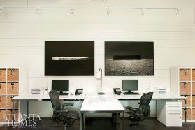Two eye-catching black-and-white photographs by Murphy take center stage on a wall in Amy Morris' design studio.