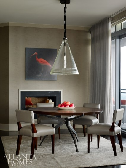 A painting of a bird adds a dash of color to a neutral space by William Peace.