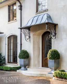 Though the home was less than 10 years old when the Bromenschenkels moved in, they were drawn to how Summerour used materials that made the home appear as if it had stood for decades. The stucco and limestone exterior, zinc pots and overhang and potted boxwoods reflect French Normandy style.