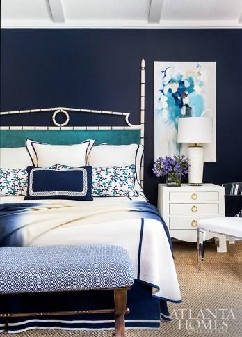 Crisp white pops against nautical navy in the master bedroom. Custom linens by Jane Wilner dress the custom-finished bamboo headboard by Louis J. Solomon.