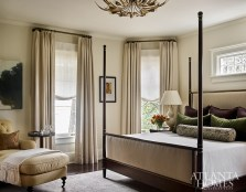 Detailed with gilding, a four-poster bed by Hickory Chair through Bungalow Classic makes a striking statement in the master bedroom. The antique chandelier is from Jean-Marc Fray.