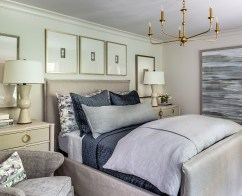An upholstered slipcovered bed ushered in a slimmer profile to maximize space in the guest bedroom of the 2019 Home for the Holidays Designer Showhouse.