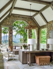 White pottery lamps from Lush Life play off of the modern chairs from Janus et Cie on the covered back porch with spectacular mountain views.