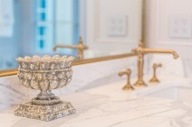 In the master bathroom, personal details and little luxuries, such as these Kohler faucets, add a layer of personality.