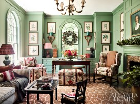 Kirkland transformed the study, originally a more formal library space, into an intimate lounge area for the empty-nester homeowners to enjoy together. She also adorned the walls, painted Farrow & Ball's Calke Green, with the homeowners' collection of antique engravings.