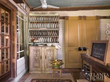 The wall plate rack was fashioned out of an old blanket truck that he reconfigured.