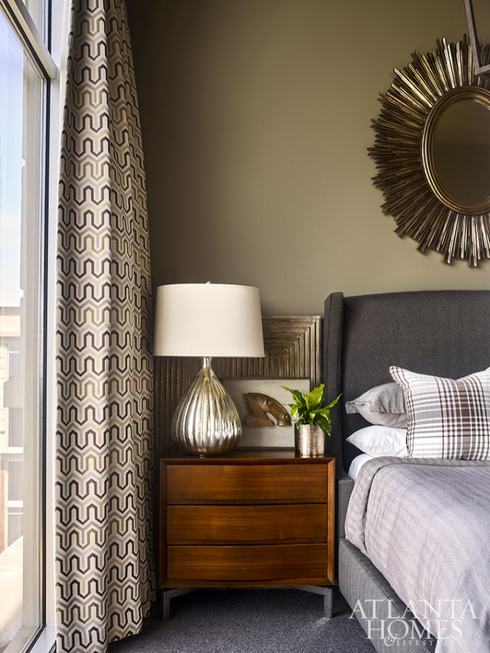 A hotel-like retreat, the guest bedroom is furnished with bedside tables by Mitchell Gold + Bob Williams. The mercury glass lamps are by Currey & Company.