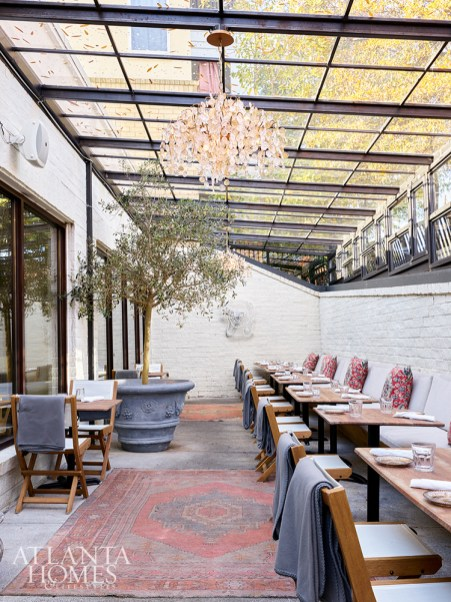 Al fresco dining is possible year round thanks to Delbar's glass-enclosed heated patio and blankets provided to cover guests' legs.