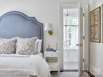 The bed frame is upholstered in Velluto's Dusk velvet through Designers Guild and the bedding is through The Linen Ladies. The Euro shams are covered in Lee Jofa's Thai Lotus Blue fabric, which informed the color scheme for the rest of the room.