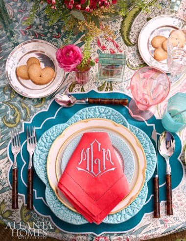 Layers of patterns and colors dazzle the eye, including monogrammed napkins and tortoise shell flatware.