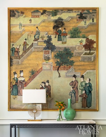 A framed piece of the dining room's original mural honors the history of the house.