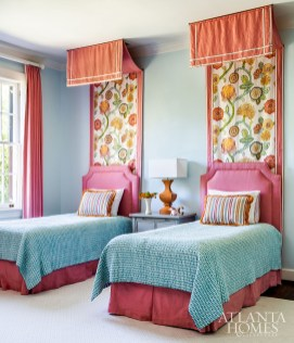 Colorful custom bed hangings by Duralee play off the twin headboards, bold draperies and patterned bedding in the children's bedroom.
