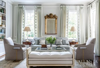 A 17th-century American rococo mirror from Foxglove Antiques & Galleries makes a statement above the plush contemporary sofa in this historic Georgian Revival abode originally designed by Neel Reid.