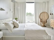 "Mixing styles and periods, Malone set a serene scene in the main bedroom. ""It's a quiet refuge,"" she says."