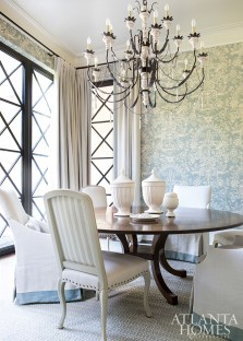 One of many blue hues throughout the home, a patterned wallcovering adorns the walls in the breakfast room while coordinating closely with the lacquered cabinetry in the nearby butler's pantry.