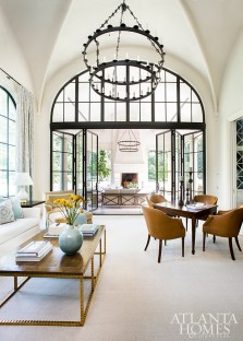 A plush sofa from Baker and slipper chairs by Suzanne Kasler for Hickory Chair complement the family room's airy appeal.
