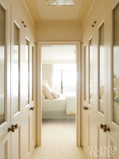 A pass-through hall between the master bedroom and bath doubles as closet space.