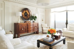 Most of the furnishings and accessories spark a memory for the couple, such as the concave mirror found at a Parisian flea market and antique sideboard purchased from the South of France.