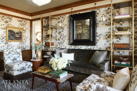 """Rose & Hydrangea by Cowtan & Tout takes center stage in the family room. The classic print inspired designer Phoebe Howard to introduce another enduring pattern—leopard—underfoot. She recalls finding the portrait of the old man """"on the floor out in a field in France on a cool day."""""""
