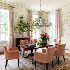 A French-style chandelier found years ago in New York hangs above an antique English dining table. The silk rug was sourced through a specialist the Morrows encountered on a trip through Turkey and the Greek islands.