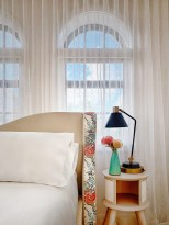 The hotel's rooms and suites feature a neutral, textured palette accented by original modern art, verdant live plants and thoughtful pops of color.
