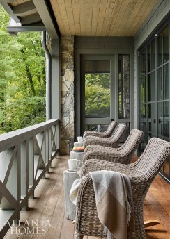 Rocking chairs by Kingsley Bate through AuthenTEAK make the most of the lake ambiance.