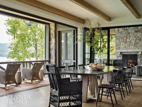 Thanks to folding doors that open to a rocking chair porch on one side and a screened porch with a fireplace, grill and lounging area on the other, the dining room allows the homeowners to dine alfresco regardless of the conditions.