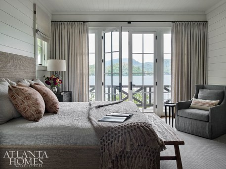 The primary bedroom's swivel rockers are an ideal spot to start the day. Because of the home's positioning, lake views can be enjoyed in nearly every room of the house.