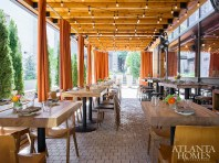 Curtains on Storico Vino's outdoor patio can be closed for a more private alfresco experience