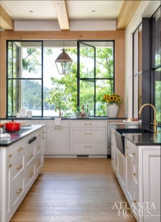 To accommodate the wife's taller stature, the cabinets were fabricated in a custom height. They're topped with black soapstone for durability.