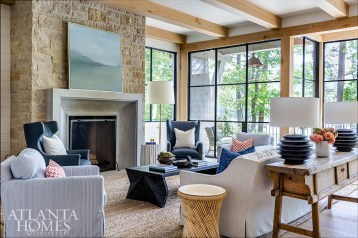 Interior designer Nancy Duffey selected a range of indoor-outdoor fabrics to ensure the furnishings could hold up to lake life. She comfortably mixed styles in the living room, such as an antique console from South of Market with a more modern coffee table from Palecek. The fireplace by Ryan Duffey offers a similar juxtaposition with traditional stacks of stone mingling with a contemporary concrete surround.