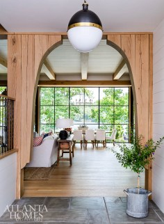 A panoramic lake view, framed by a white oak archway, greets guests upon arrival.