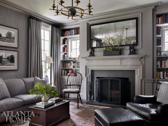 Bozeman created a more masculine feel in the study, where the husband listens to music and watches golf. A gray-blue Phillip Jeffries wallcovering complements the room's paint color, Benjamin Moore's Winter Gates.