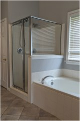 BEFORE - Designer Theresa Ory replaced the existing shower and bathtub with a curvy zero-entry shower.