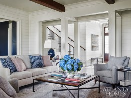 For a comfortable and relaxing great room—where the homeowners' two dogs love to lounge on the sofa—Wilkins incorporated tons of texture, which not only adds interest, but is also forgiving to any stains or spills. The sofa and armchair are through Hickory Chair and the rug is from Keivan Woven Arts.