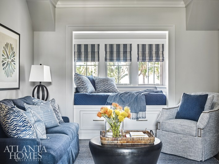 """Right outside the bunk room is a TV lounge where the homeowners' grandchildren can gather. """"You can pile a bunch of grandchildren and all their friends in there and they can just have a great time,"""" says Wilkins. The armchair is through Hickory Chair and the sofa is Lee Industries."""