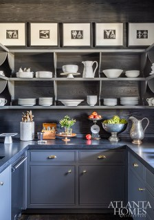 The butler's pantry features striking juxtapositions of dark and light hues.