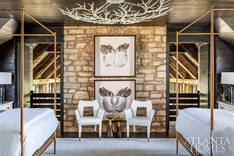 The Rainforest chandelier by Currey & Company through UpCountry Home hovers above a pair of Hamilton beds by Made Goods.