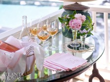 The pink palette is continued in vintage monogrammed cocktail napkins at the drinks table.