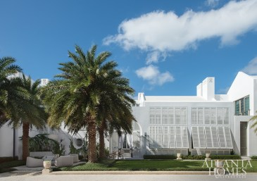 """In Alys Beach, Florida, a modern stucco façade with louvered shutters provides for both breezes and privacy. It's clean and almost monolithic,"""" says architect Bill Ingram."""