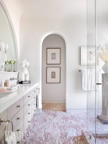 arched doorway in bathroom with eye-catching tile