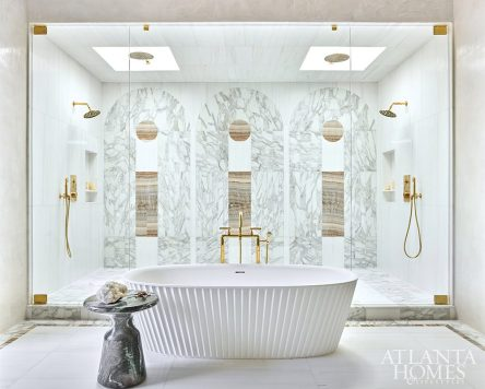 fluted tub a glass wall shower