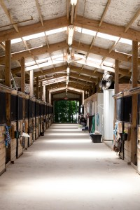 looking down the breezeway of one of the stables.