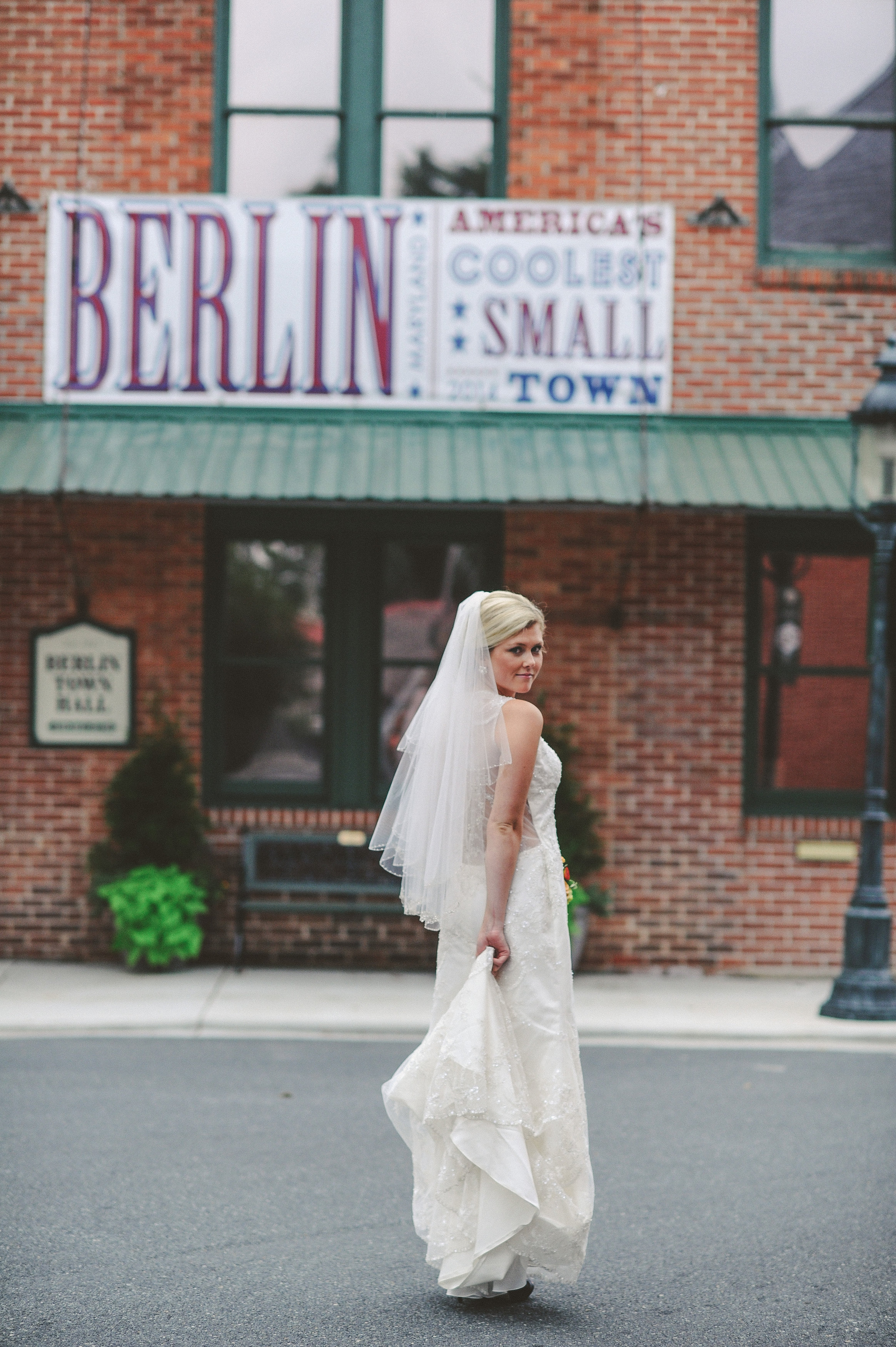 Weddings Main   The Atlantic Hotel   Historic Berlin MD Bride wearing Bustle Bridal Gown on the street of Berlin MD Americas  Coolest Small Town